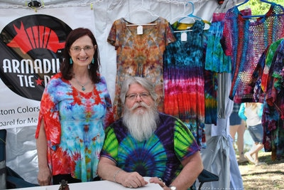 Man and woman at tie dye booth