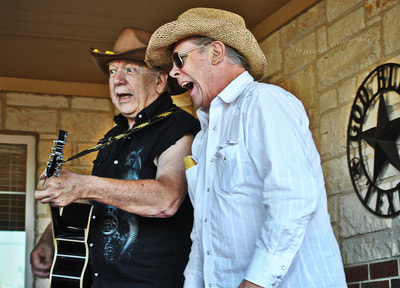 Two cowboys singing
